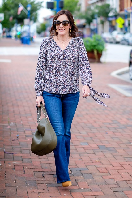 With flare jeans, olive green bag and brown shoes