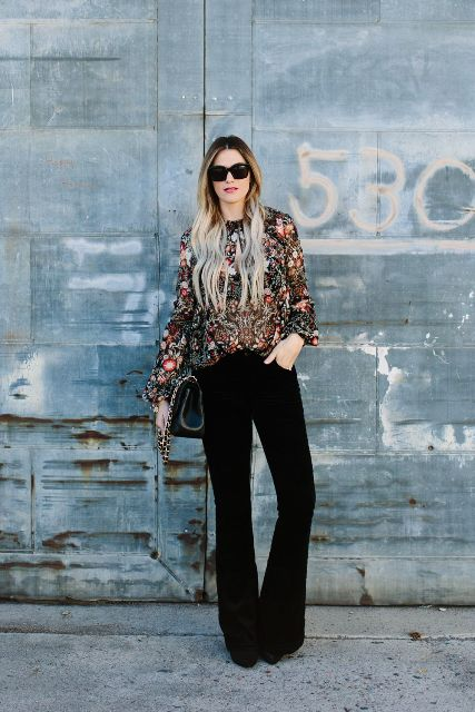 With floral blouse, black bag and black boots