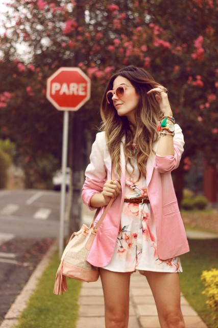 With floral romper, belt and beige bag