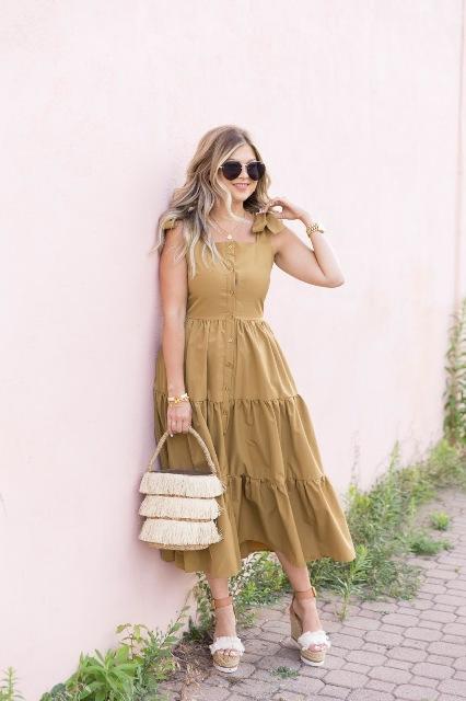With fringe bag, platform sandals and oversized sunglasses