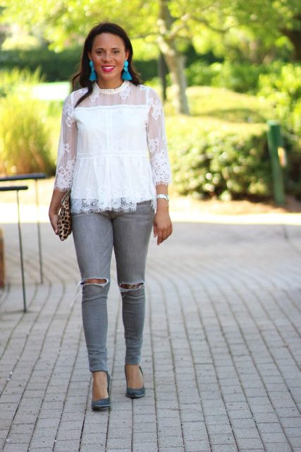 With gray distressed jeans, leopard clutch and pumps