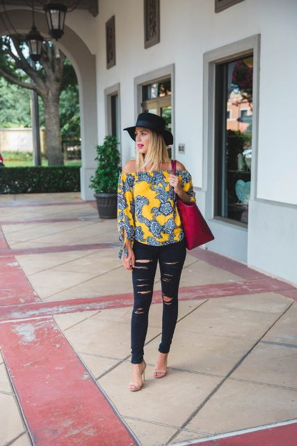 With hat, red tote, distressed jeans and high heels