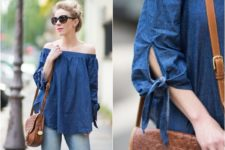 With jeans and brown leather bag