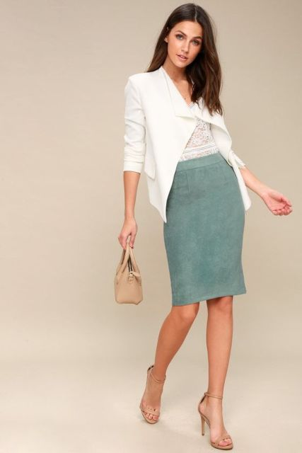 With lace top, white blazer, beige bag and high heels