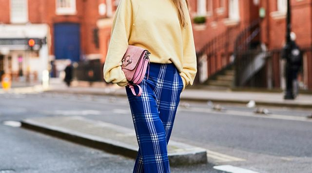 With light yellow sweater and pink bag