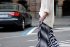 With loose sweater and platform shoes