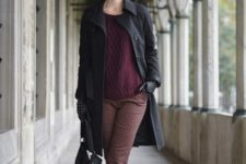 With marsala sweater, black bag, lace up boots and black coat
