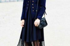 With navy blue blazer, black small bag and white and black platform shoes