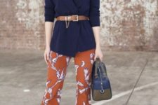 With navy blue cardigan, brown belt, two colored bag and floral blouse