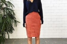 With navy blue loose shirt and black cutout shoes