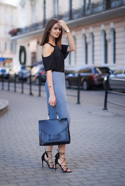 With off the shoulder shirt, black tote bag and lace up high heels