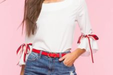 With oversized sunglasses, red belt and denim mini skirt