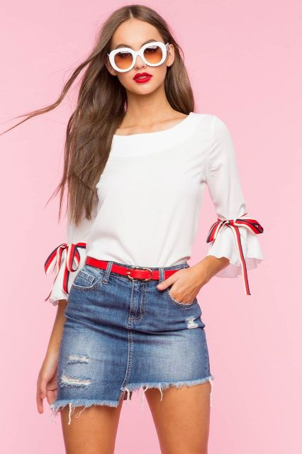With oversized sunglasses, red belt and denim mini skirt
