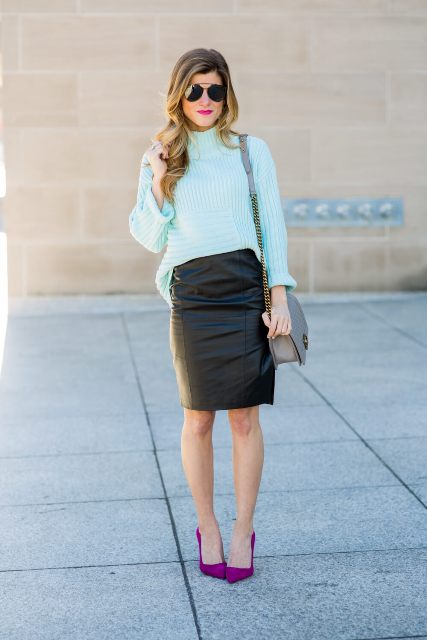 With pastel colored sweater, purple pumps and chain strap bag