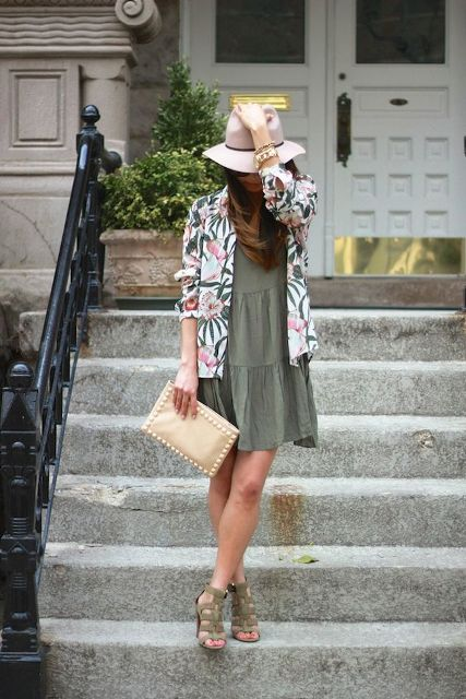 With printed blazer, wide brim hat, beige clutch and olive green shoes