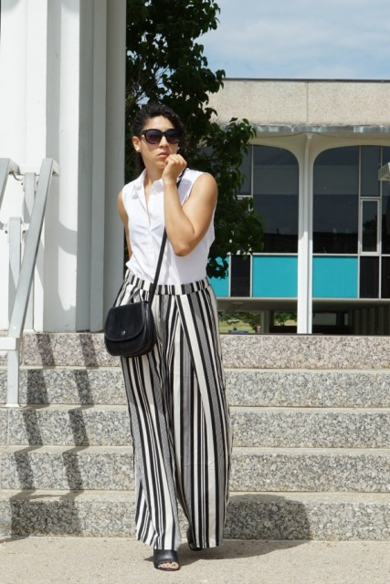 With sleeveless top, black crossbody bag and black shoes