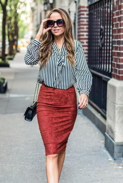 With striped shirt, black chain strap bag and sunglasses