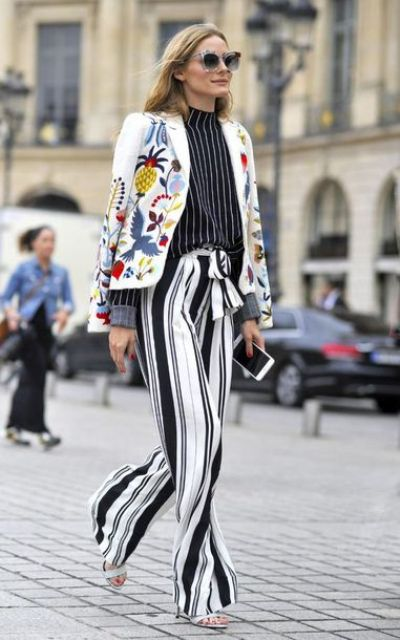 With striped shirt, printed jacket and white heels