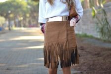 With sweater, belt, brown clutch and shoes