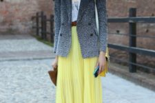 With top, yellow maxi skirt, belt and flats