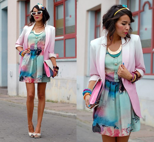 With watercolored dress, high heels and clutch