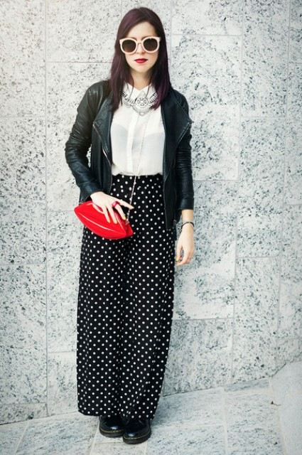 With white blouse, black leather jacket, red bag and black boots