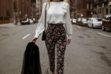 With white blouse, black shoes, black jacket and small bag