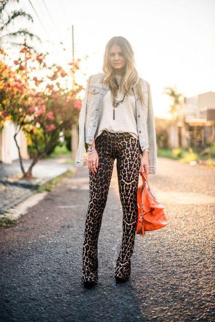 With white blouse, denim jacket, black shoes and orange bag