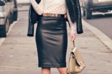 With white blouse, metallic belt, beige bag, black leather jacket and fringe boots