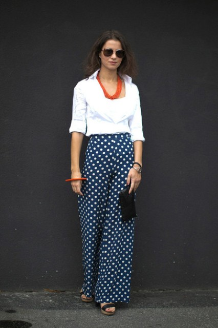 With white blouse, red necklace, sunglasses, black clutch and platform shoes
