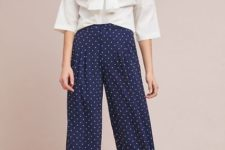 With white bow blouse and flat sandals