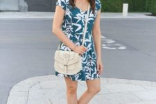 With white crossbody bag and platform shoes