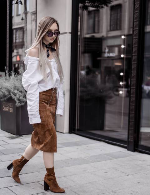 With white loose blouse and brown velvet ankle boots
