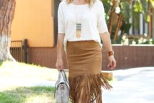 With white loose shirt, gray bag and brown sandals