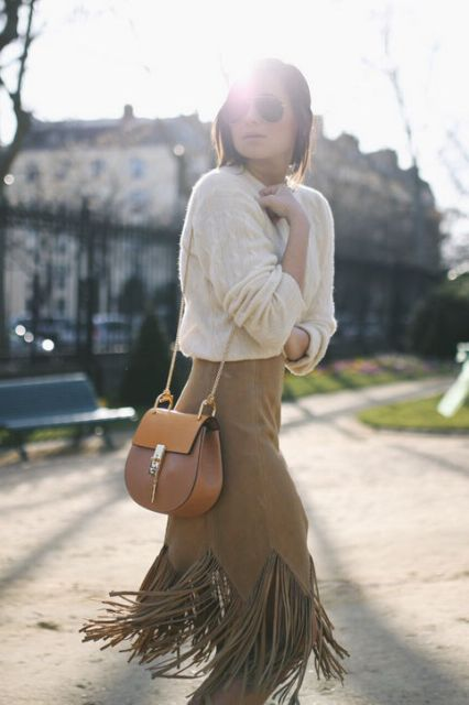With white loose sweater and chain strap bag