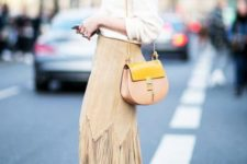 With white shirt, beige and yellow bag and white flat shoes