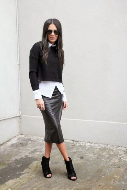 With white shirt, black crop sweater and cutout boots