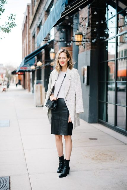 With white shirt, chain strap bag, light gray coat and ankle boots