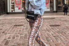 With white shirt, denim jacket, black bag and white shoes