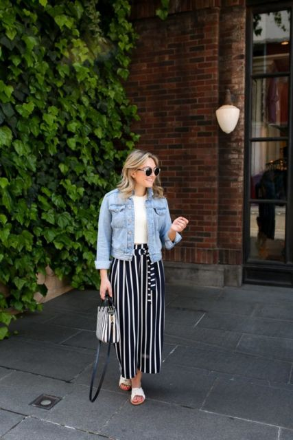 With white shirt, denim jacket, striped bag and white shoes