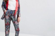 With white shirt, flat mules and floral blazer