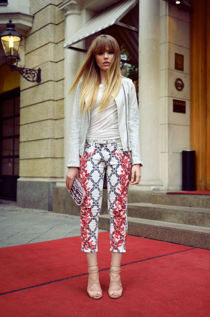 With white shirt, printed jacket, lace up shoes and clutch