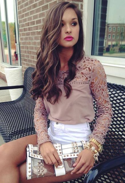 With white shorts and embellished clutch