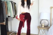 With white sweater, marsala clutch and high heels