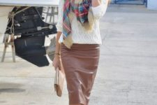 With white sweater, plaid scarf, beige clutch and beige pumps