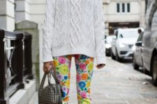 With white sweater, printed small bag and golden shoes