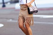 With white t-shirt, printed bag and high heels