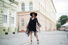 With wide brim hat and black shoes