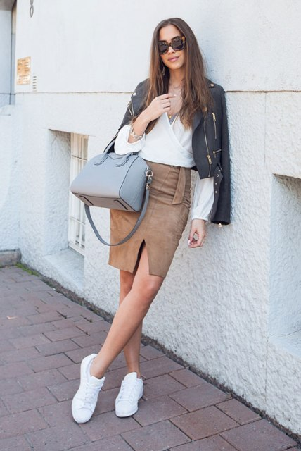 With wrapped blouse, black leather jacket, gray bag and white sneakers