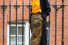 With yellow blouse, black maxi cardigan and black sandals